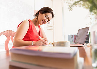 Personal Branding photoshoot of woman working at desk