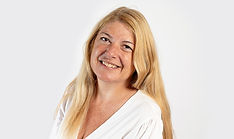 Mature executive business woman in white blouse in headshot photoshoot in Surrey