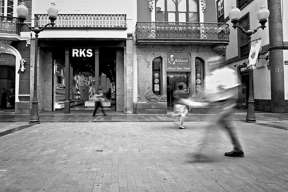 busy highstreet with shoppers using slow shutter camera speed