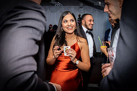 Woman doing card trick with magician at Christams event in Surey