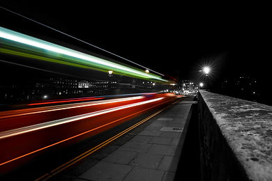 Streaks of light from a London bus using slow shutter speed commercial photography