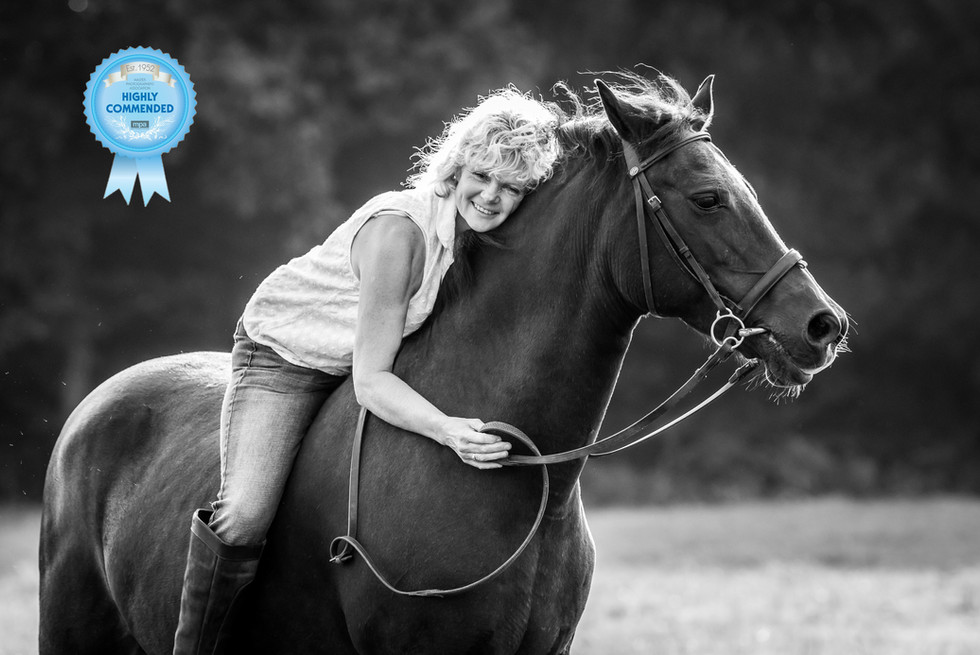 Woman loving her horse