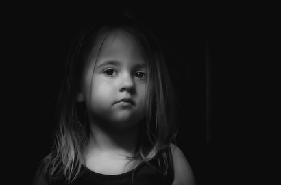 black and white portrait of a little girl with long hair in Surrey