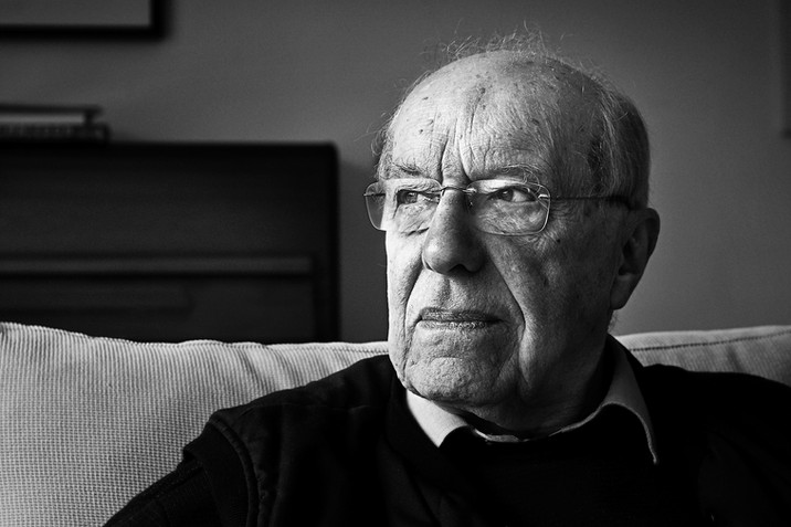 lifestlye documentary portrait of an old man looking out the window in his Surrey home