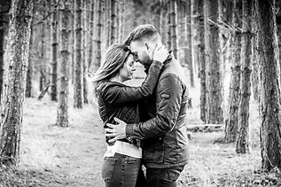 Black and white Engagement lifestyle photoshoot of a couple in a romantic embrace in Surrey Woods