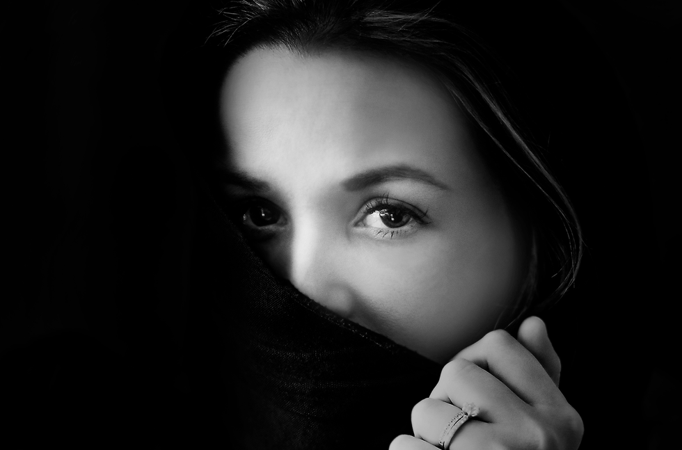 black and white portrait of woman in headscarf just showing her eyes in Surrey