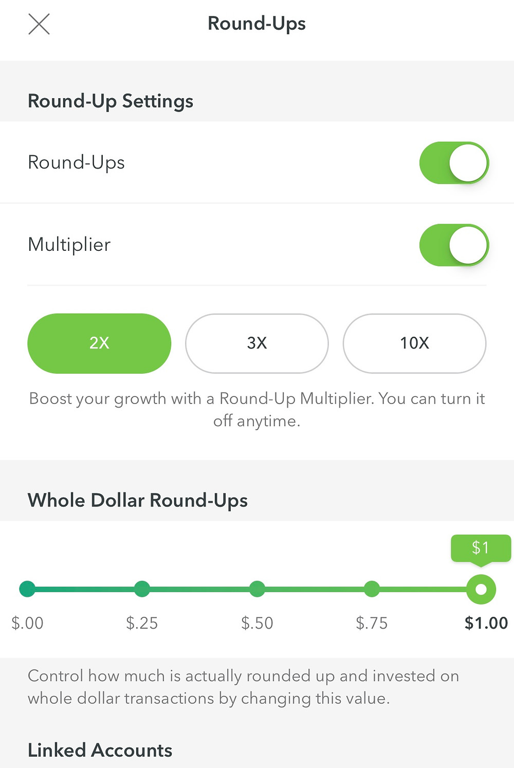 Acorns app screen showing round ups and multiplier settings