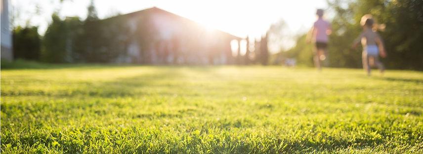 lawn-at-home-running-children-in-blur-on