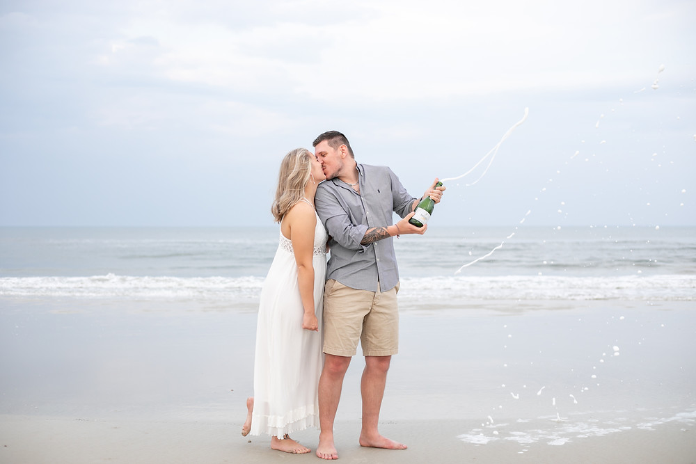 pop a bottle of champagne on the beach white light and airy st. augustine florida beach engagement session gorgeous whimsical bright and gorgeous butler crescent engagement wedding beach photography