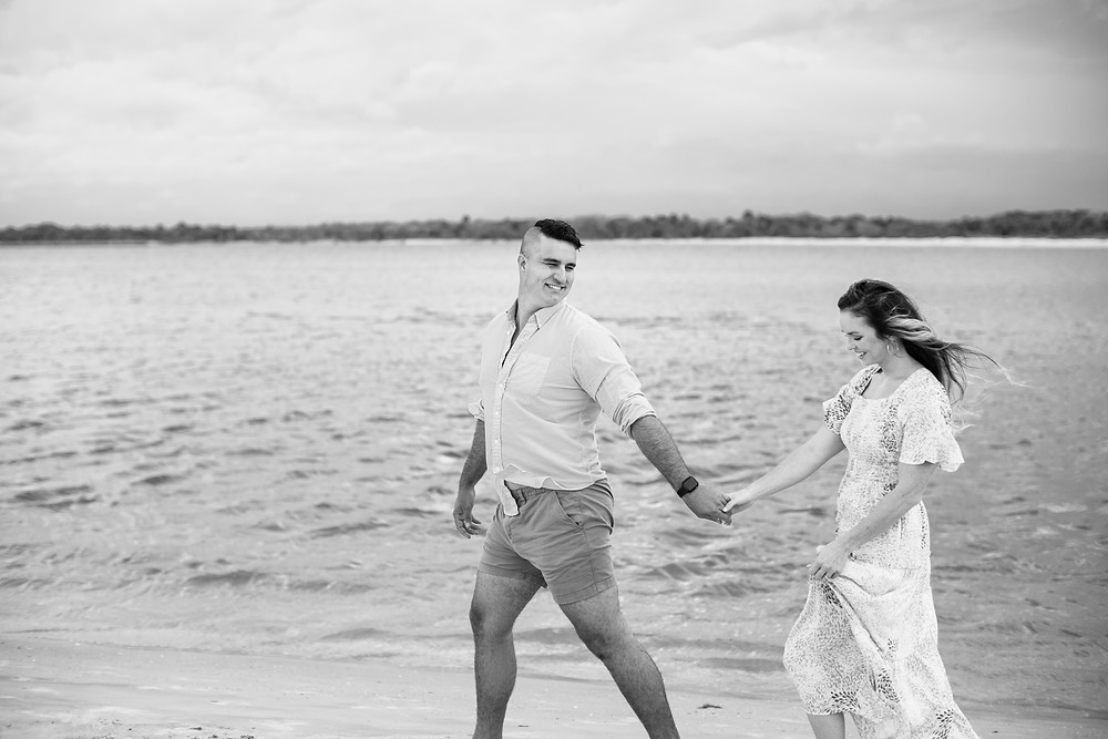 matanzas inlet beach in saint Augustine palm coast beach photoshoot engagement session gorgeous young couple light and airy black and white beautiful photographer photography wedding engagement bride and groom