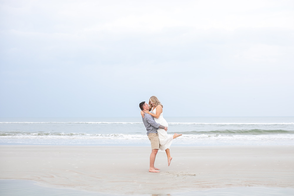 beach engagement shoot in st. augustine florida light and airy crescent beach butler beach sand photography wedding photographer florida light and airy gorgeous engagement ring