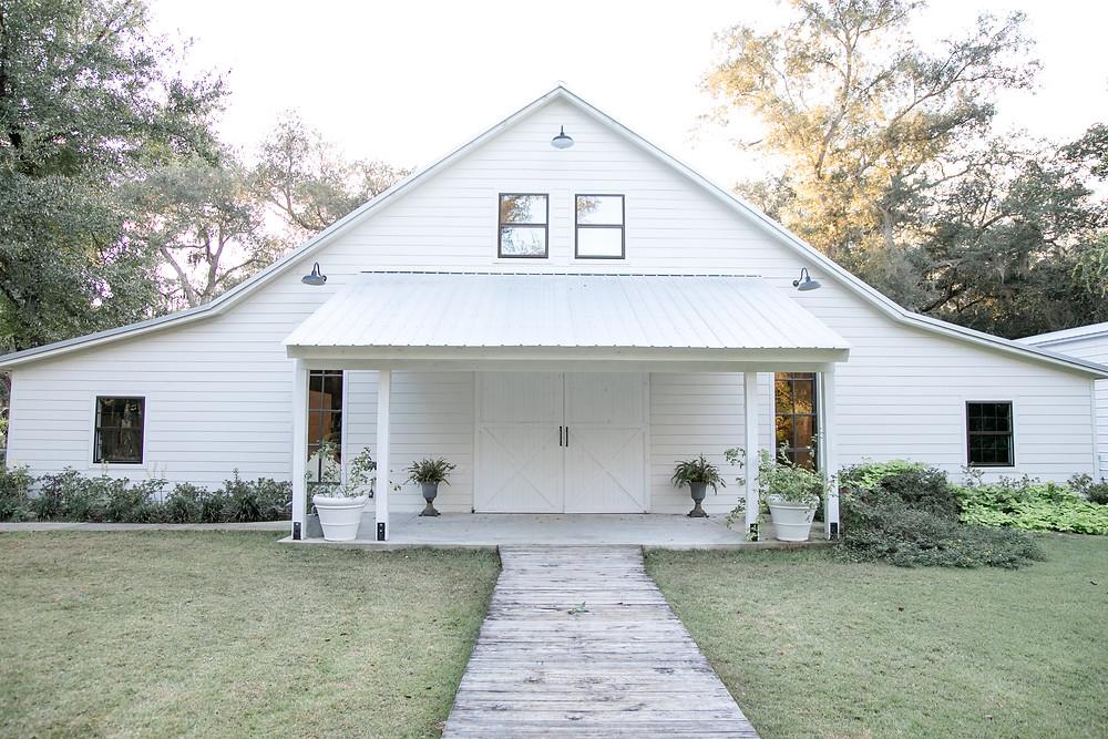 chandler oaks big white barn with gorgeous windows, barn doors and greenery