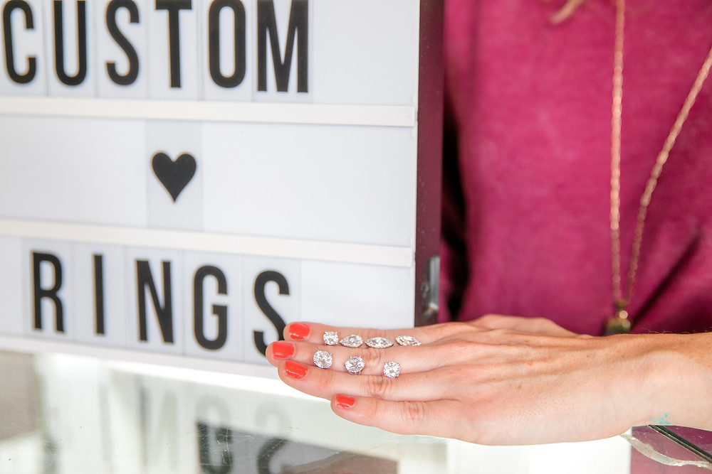 cutsom rings with diamons sustainable gems and beautiful colors with gold and silver bride groom san marco avenue in downtown st augustine heart love bride and groom