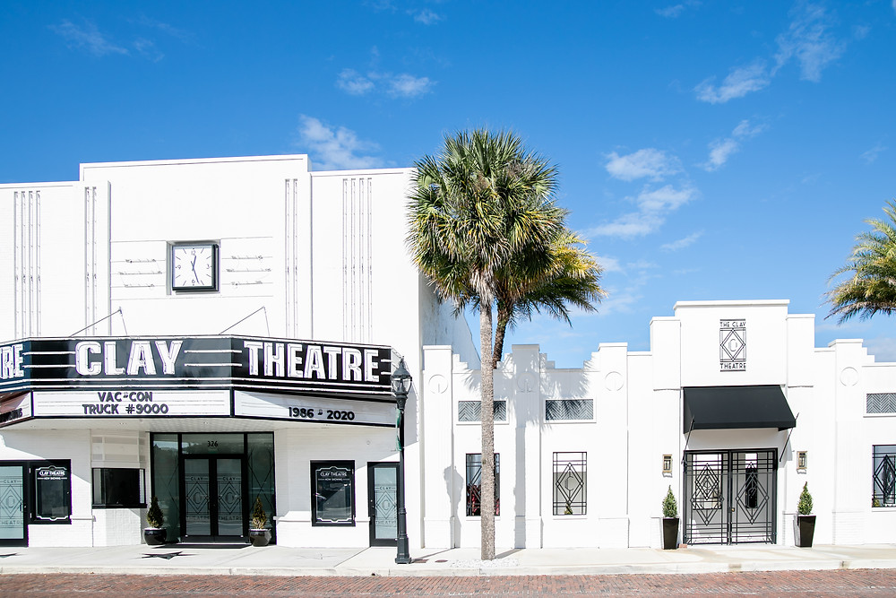 the clay theatre in green cove springs front walkway and sign with gorgeous white brick and black accents
