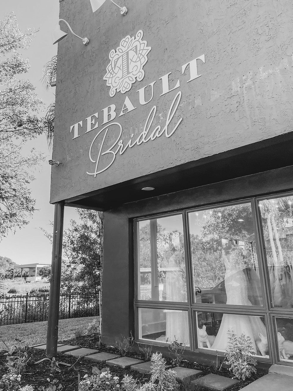 black and white photography of the wedding gown store location called tebault bridal in St. Augustine Florida