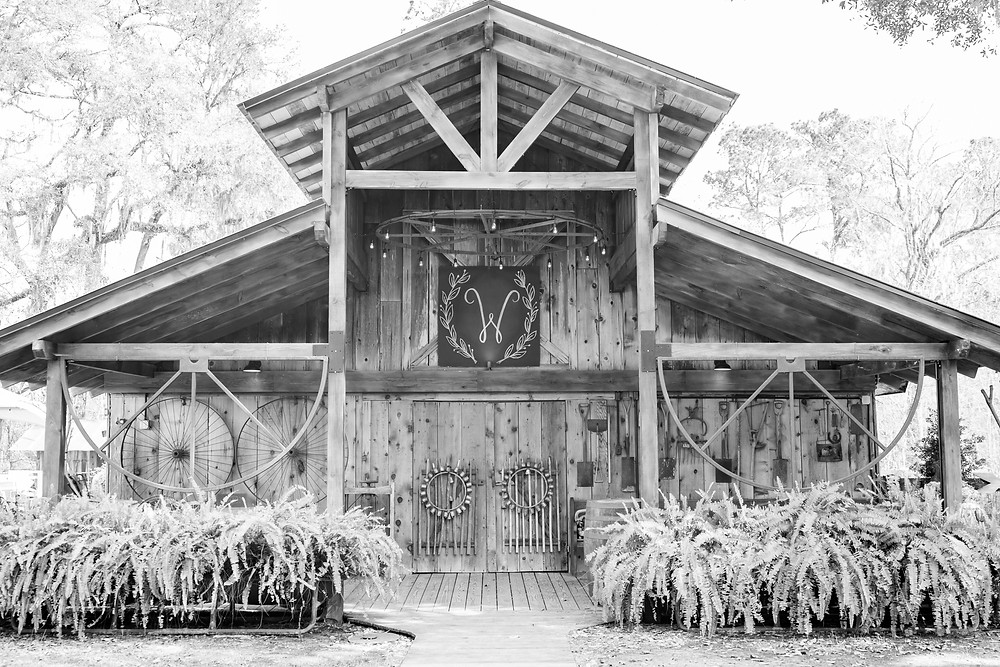 main barn at tuckers farmhouse gorgeous wedding venue in green cove springs florida close to st. augustine florida on a rustic shabby chic large calligraphy letter for your ceremony reception with barn wood