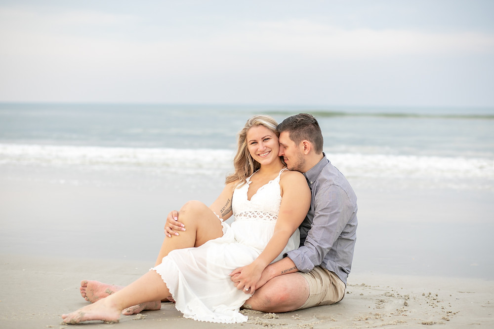 beach photography engagement engaged wedding light and airy white and blue sunset photography diamond engagement rings beautiful water and sky