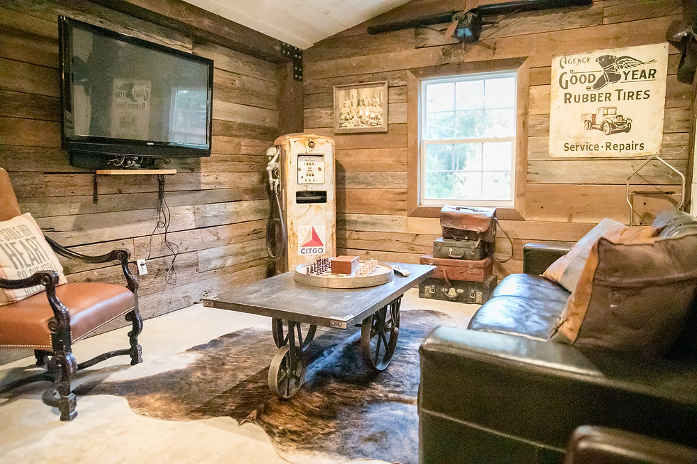 groom's suite in chandler oaks barn for grooms and wedding party with games and rustic decor including wood paneling