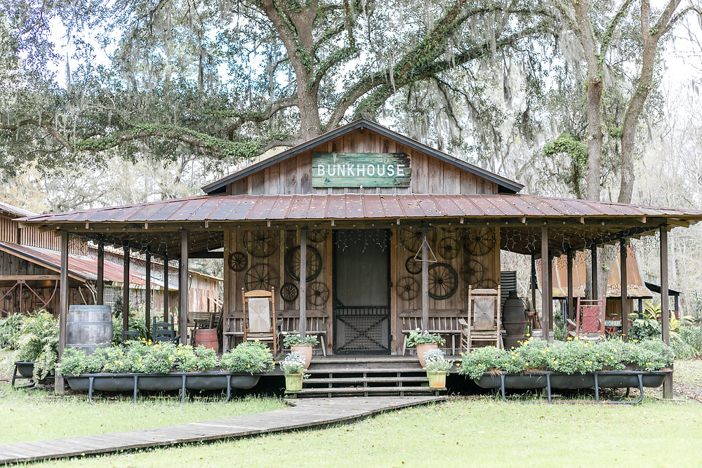 bunkhouse at tucker's farmhouse wedding venue in green cove springs florida near st. augustine and jacksonville florida antique gorgoues oak trees and shabby chic decor