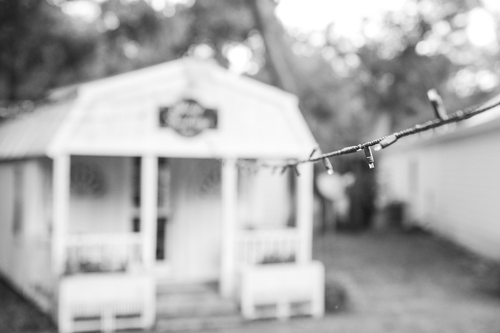 the chandler oaks ice cream shop and string lights in black and white on the wedding property
