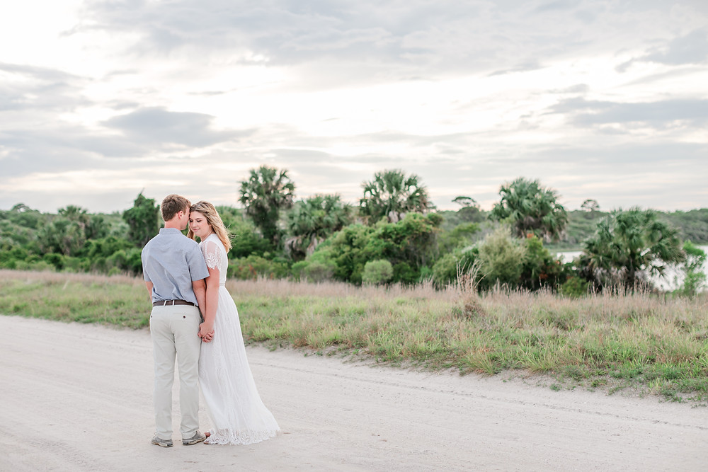 engagement session, beautiful greenery light and airy water front guana state park diamond ring in love bride and groom