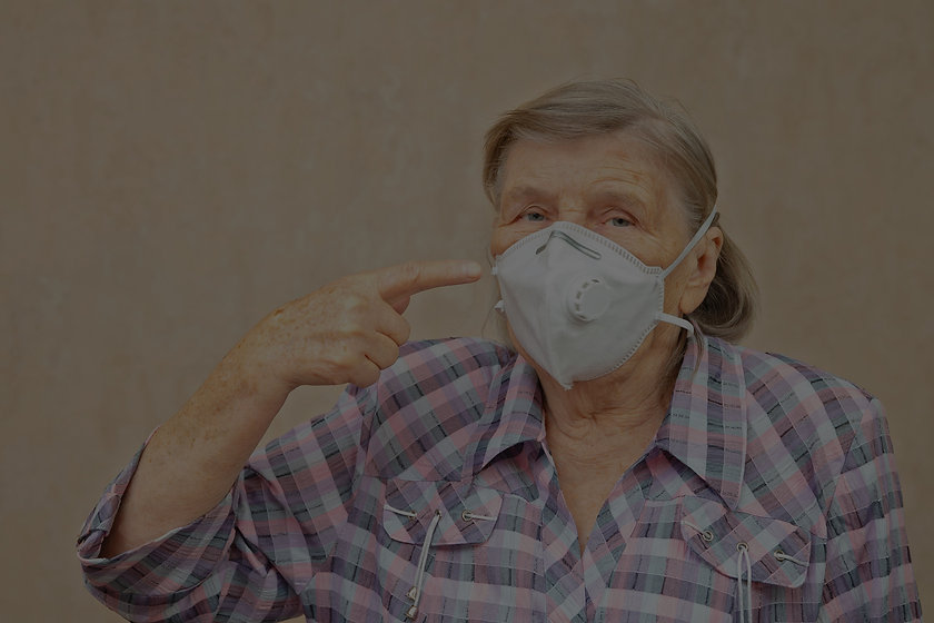 elderly-woman-shows-wear-protective-mask