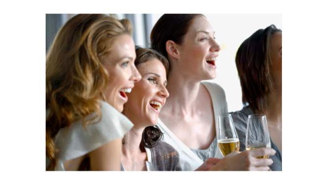 Women laughing and drinking champagne