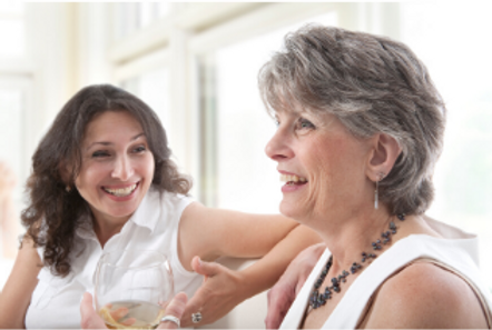 Women laughing and talking