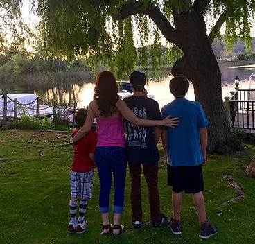 Carol Harmon of Core Functional Wellness and her children by the lake