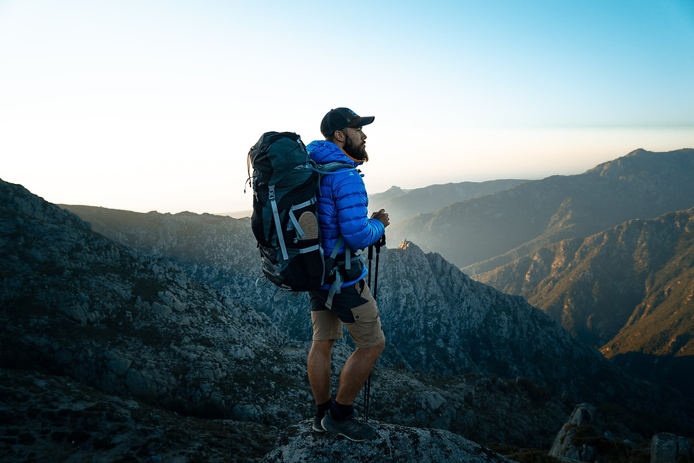 Man backpacking on mountain