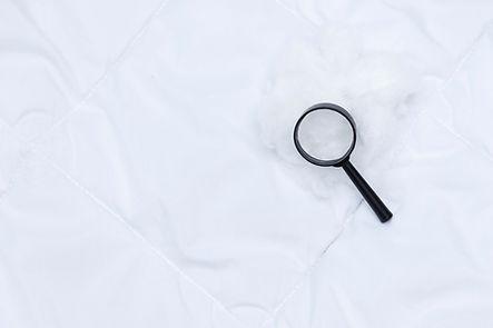 black-magnifier-lies-white-blanket-detec
