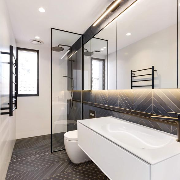 Modern style bathroom renovation with feature herringbone tiling