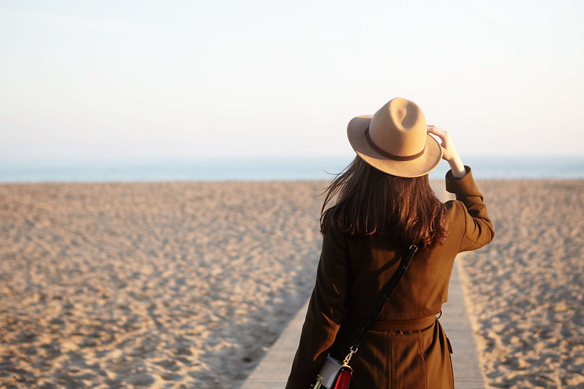 side-view-beautiful-female-stranger-autumn-sand-beach-brunette-woman-looking-into-distance