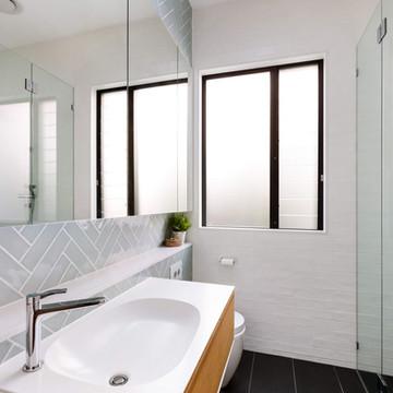 modern bathroom renovation sea green subway tiles.jpg