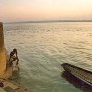 Ganges river bather and boat