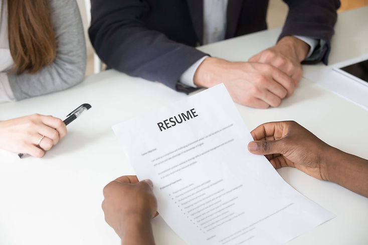 african-american-applicant-holding-resume-job-interview-close-up-view (1).jpg
