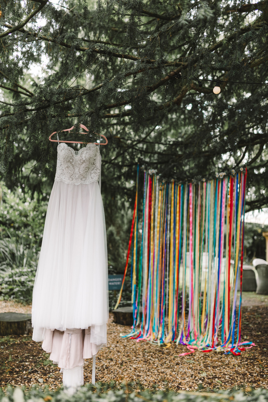 wedding dress in front of ribbons