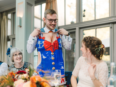 groom wearing apron