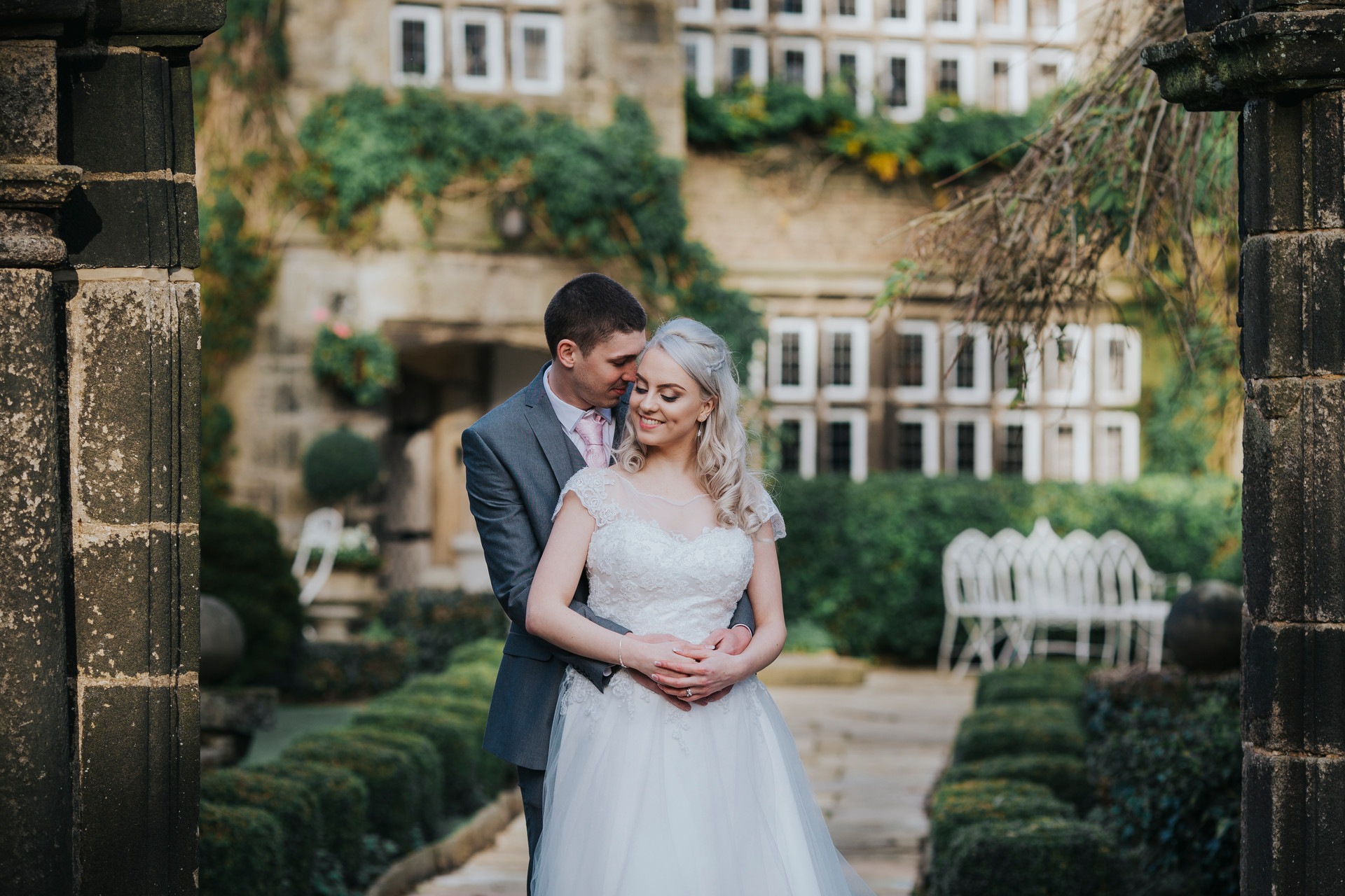 bride and groom infront of holdsworth house hotel
