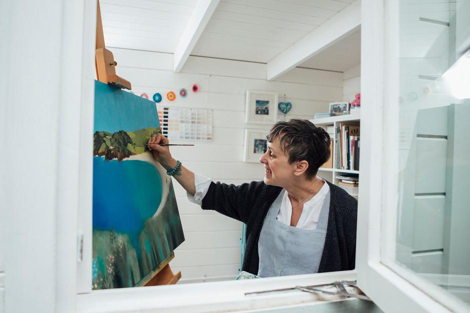 an artist paints a lanscape in leeds