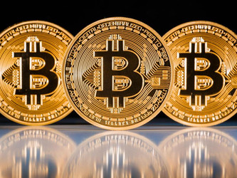 Bitcoins: Real Currency or Funny Money