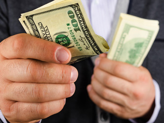 How Much Money Should You Invest In Your Speaking Career?