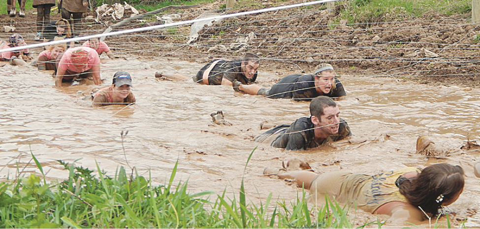 In last year's Daniel Barden Mudfest participants swam under barbed wire to reach the next obstacle at MKJ Farms in Deansboro.