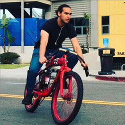 deano-riding-motorized-bicycle