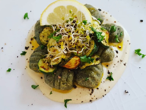 Sweet Potato Spirulina Gnocchi with Zucchini on Cauliflower Alfredo