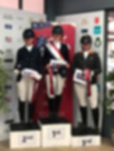 Olivia on the winners podium at Wellington