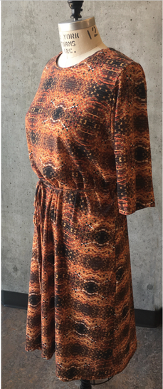 A knit dress made from digtiallly printed fabric with imagery from weaving together photographs.