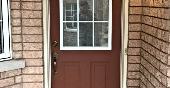 Old red door with glass frame