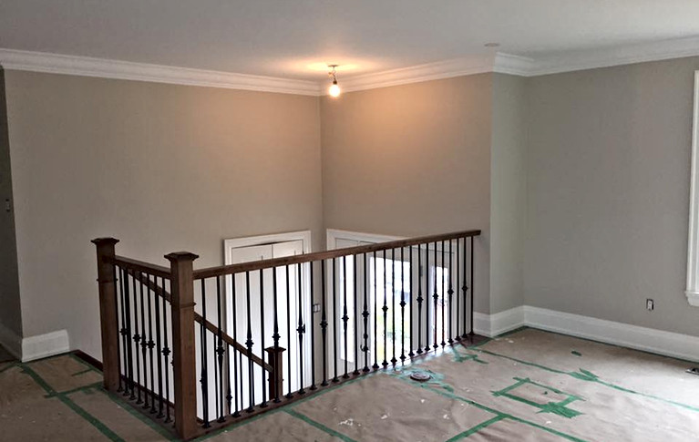 Iron and wood wrap around railing