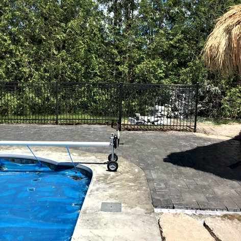Grey Interlocking brick pool deck